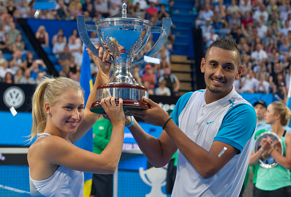 Nick Kyrgios and Daria Gavrilova of the Australia Green team celebrate with the Hopman Cup after defeating Alexandr Dolgopolov and Elina Svitolina of Ukraine during their mixed doubles final match of the Hopman Cup tennis tournament in Perth on January 9, 2016.     AFP PHOTO / Tony ASHBY   -IMAGE RESTRICTED TO EDITORIAL USE - NO COMMERCIAL USE / AFP / TONY ASHBY        (Photo credit should read TONY ASHBY/AFP/Getty Images)